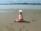 Naked baby on the beach